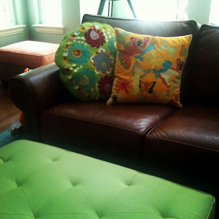 Fun and fresh new pillows with an ottoman covered in an outdoor fabric for easy cleanability