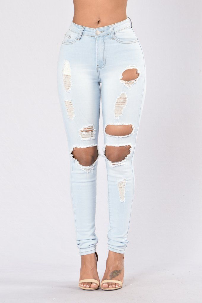 - Available in Light Wash - High Waist - 5 Pocket Design - Heavily Distressed - Skinny Leg - 71% Cotton, 27% Polyester, 2% Spandex