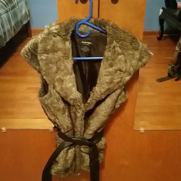 Fur vest Fun fake fur vest.....excellent condition. ...Like new...beautiful vest...leather tie Tops