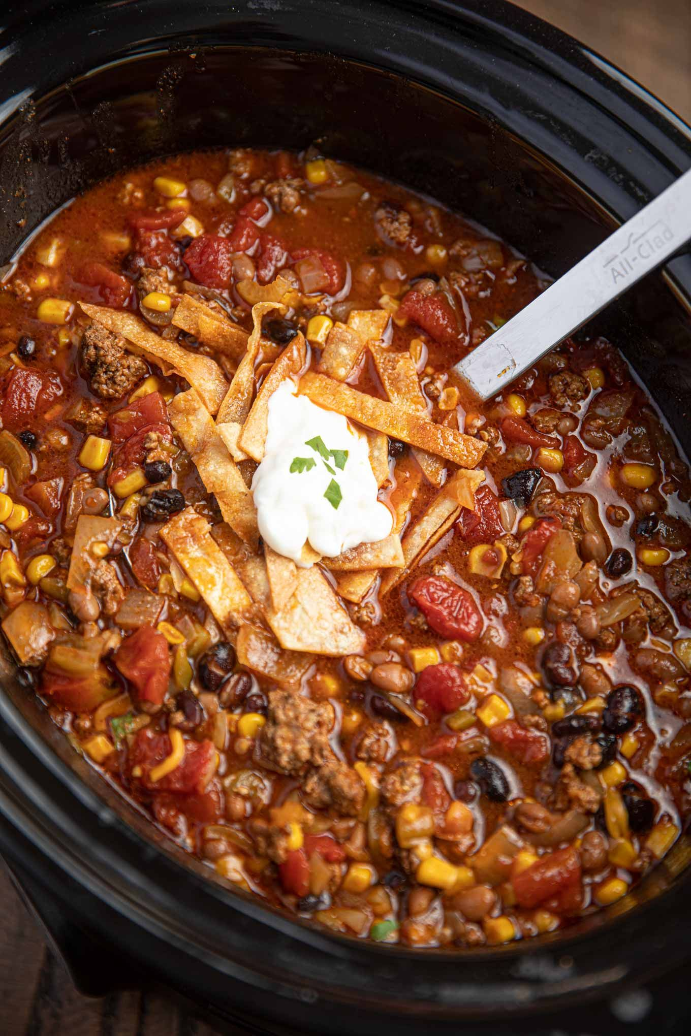 Slow Cooker Taco Soup Is An Easy Hearty Soup With Ground Beef Taco Seasoning Kidney Beans Tomatoes Slow Cooker Tacos Soup With Ground Beef Taco Soup Recipe