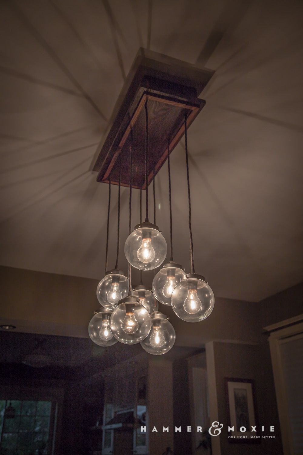 homemade chandelier with irregularly hung globes, cotton-covered wiring,  and a ceiling box made of reclaimed wood | hammer & moxie