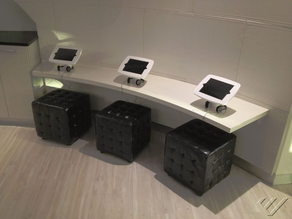 orthodontist waiting room with tryten ipad kiosks
