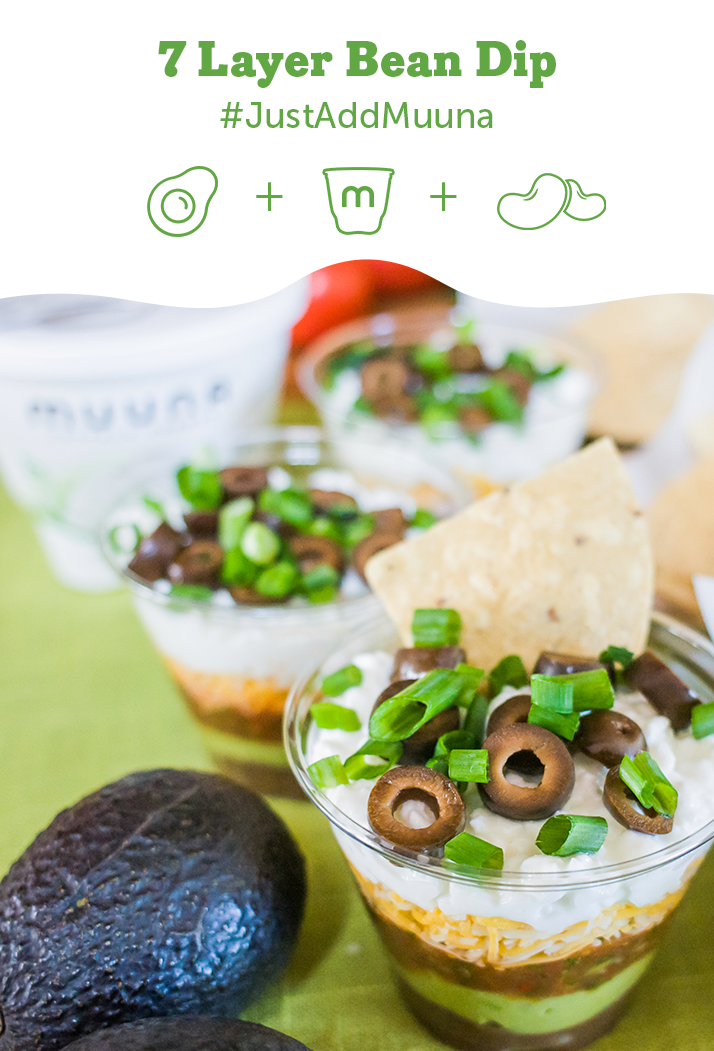 Fuel the party with these perfectly-portioned 7-layer Mexican dip cups featuring creamy Lowfat Muuna cottage cheese as the top layer! #CincoDeMayo