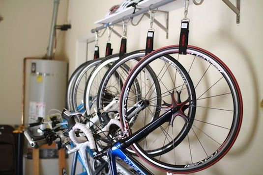 If You Have A Large Family With A Set Of Many Bikes Hanging Them Might Be A Better Solution Bike Storage Diy Bike Storage Garage Garage Organization