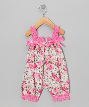 Decked with a charming floral print, this romper makes everything from snack time to nap time a whole lot fancier. Stretchy straps allow for growth and comfort, while a bubble silhouette adds a final note of precious.