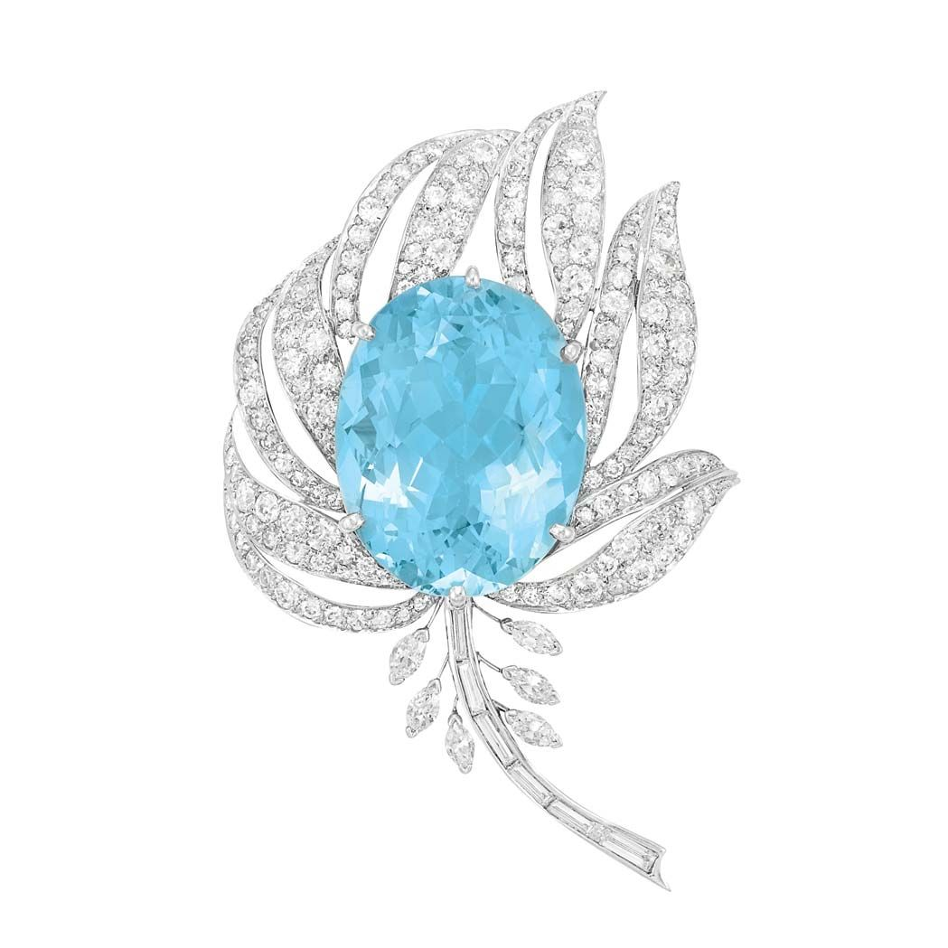 Platinum, Aquamarine and Diamond Flower Brooch   Platinum, centering one oval aquamarine approximately 30.50 cts., amidst flared pierced petals set with 150 old European-cut, round and single-cut diamonds, accented by a stem set with 6 baguette diamonds, flanked by 6 marquise-shaped diamonds, total approximately 6.25 cts., pendant loop added later, approximately 17.7 dwt.