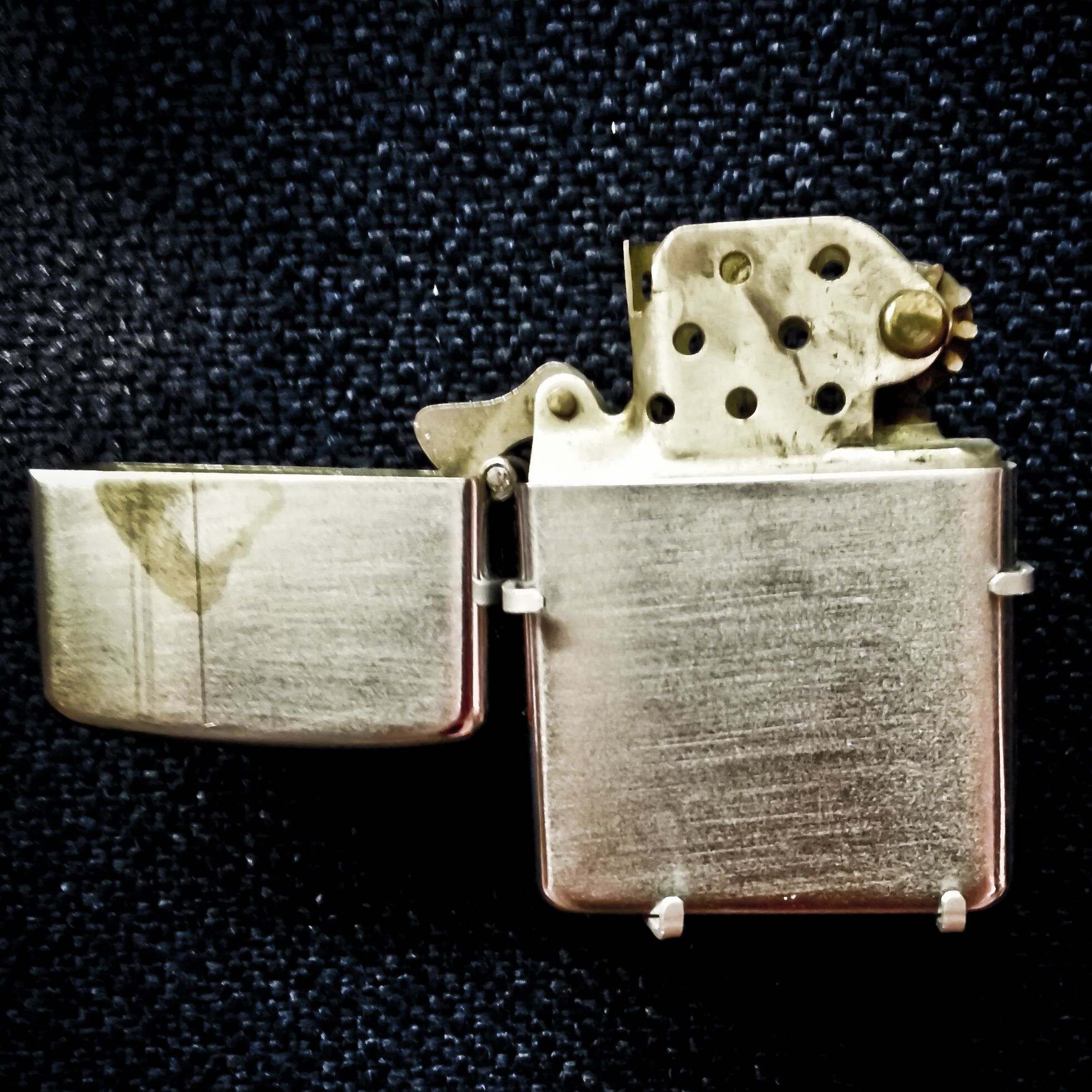 World Map Zippo Lighter. This Zippo lighter prototype designed to automatically light when the lid  was opened Currently located