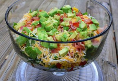 Southwestern Layered Salad   Think I may add a meat & make a dinner out of it! Maybe some lime as well