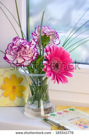 Pink carnations and gerber daisy flowers bouquet in a vase