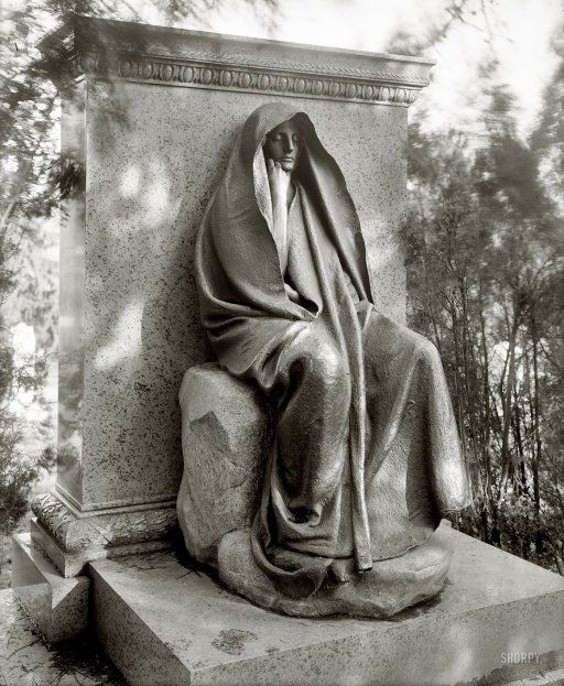 """Washington, D.C., circa 1915. """"Grief monument, Rock Creek cemetery."""" Augustus Saint-Gaudens's ambiguously enigmatic bronze memorializing Clover Adams, the society hostess whose suicide led to its commission by her husband, the writer Henry Adams."""