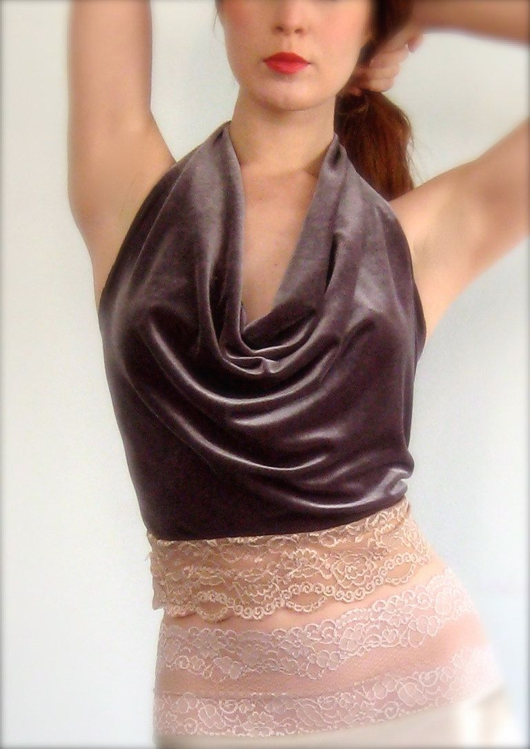 "Poema by Hannah Louise is an independent line of tango clothing made in Portland OR. Many pieces are made of silk. From the designer: ""Danceable finery is difficult to come by. In constant search of garments that allow a full range of movement, flatter the tango body, and are constructed of quality materials, I began to simply make them for myself. After pressing requests for clothing from other tangueras, poema was born."""