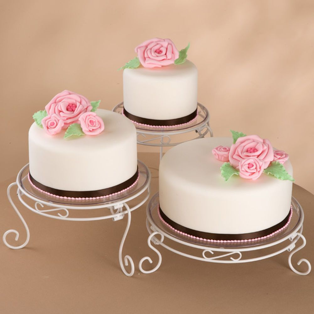 Stunning hand-rolled fondant roses are formed in dainty ...