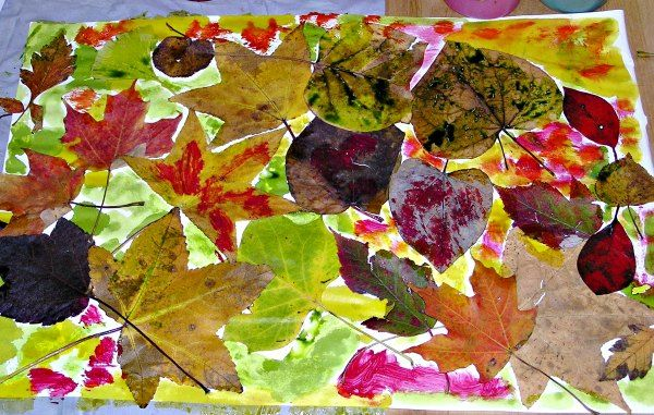 """Simple fall leaf art project for kids - these leaves have been glued onto paper & then painted on with liquid watercolours... from What Do We Do All Day ("""",)"""