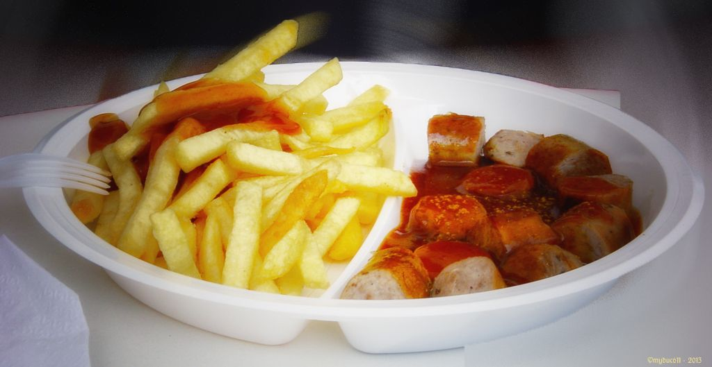 "Beloved German fare: ""Currywurst"" (pork sausage with curry-ketchup-sauce) and french fries. Fast food by the Baltic Sea · 2004."