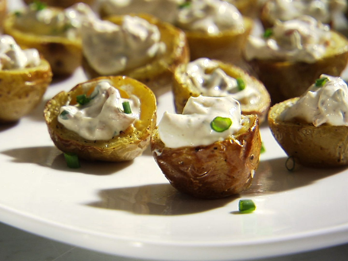 Crispy Baby Potato Bites with Sour Cream and Bacon from FoodNetwork.com