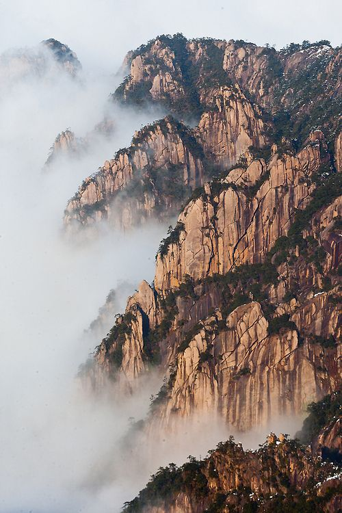 de-preciated:  Huangshan or Yellow Mountain, southern Anhui province, China (by Prasit_Chansareekorn)  Huangshan or Yellow Mountain is a mountain range in southern Anhui province in eastern China. The range composed of material that was uplifted from an ancient sea during the Mesozoic era, 100 million years ago.