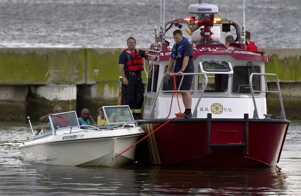 Newport News Fire and Rescue boat towed in another boat to Windward Marina in Newport News after the rain storm ended. (Joe Fudge / June 25, 2012)