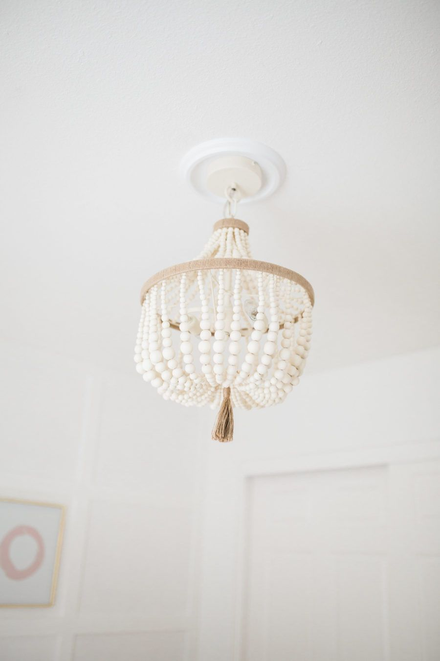 Bright white pastel baby girl nursery reveal wood bead wood bead chandelier nursery lighting nursery chandelier baby girl nursery aloadofball Image collections
