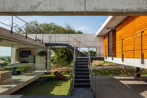 By distributing spaces on different levels, each room of this #Brazilian #house enjoys view, ventilation and natural light #staircase #outdoor #courtyard