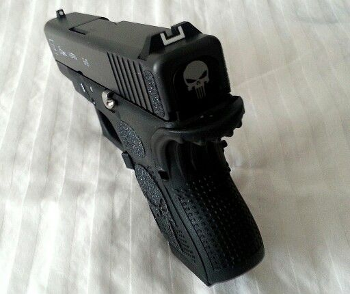 Gen 4 Glock 26 with stainless steel pins, punisher grip and slide cover