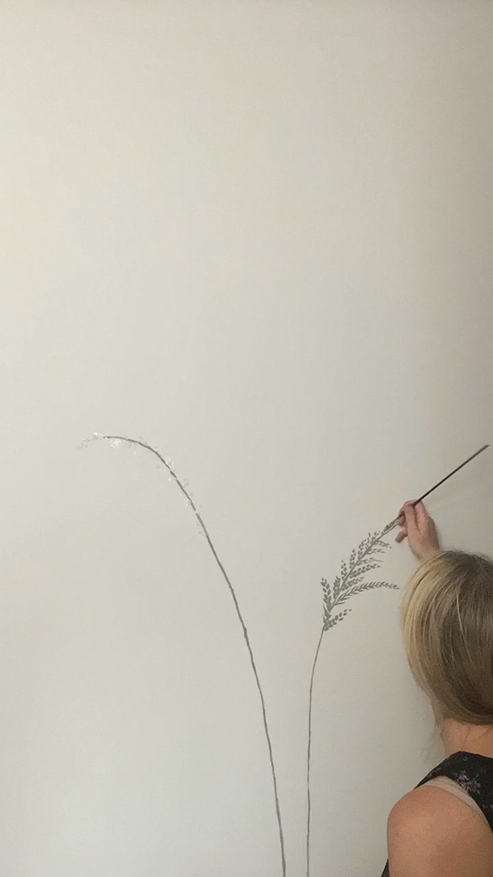 Mural wall artist Nicola Hill-Gregory painting freehand wall mural for adult bedroom. Brief: calm, natural and pretty