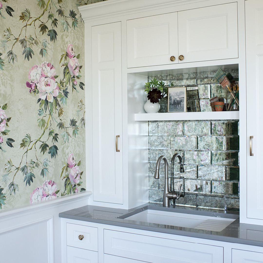 Romantic floral wallpaper, an antiqued mirror-tile ...
