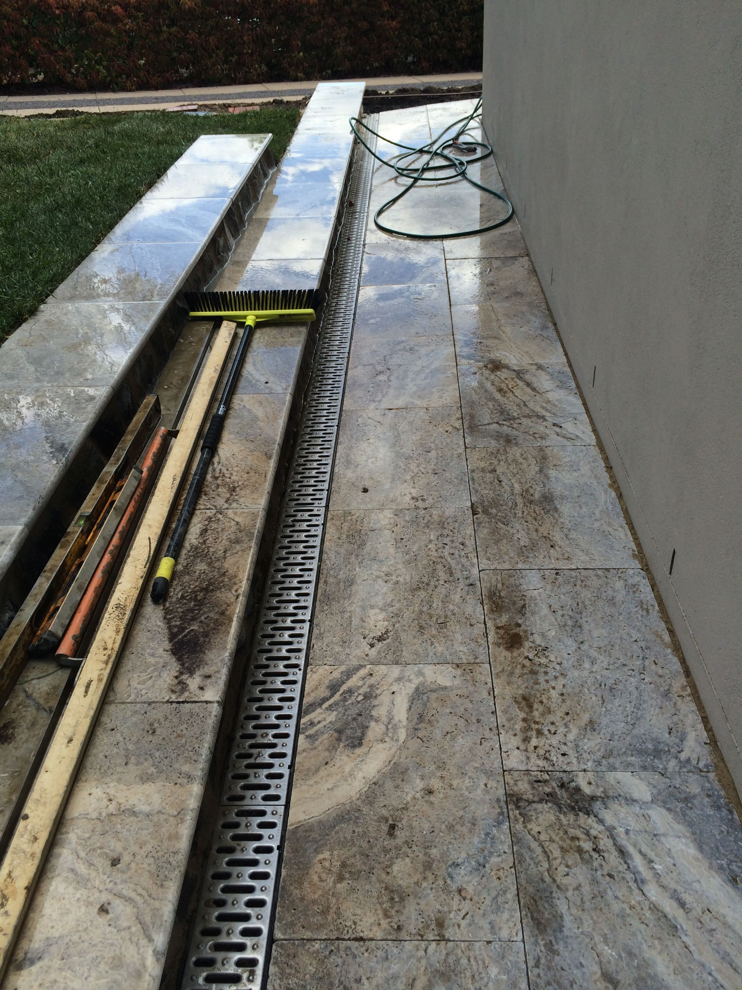 long steps. channel drain. travertine