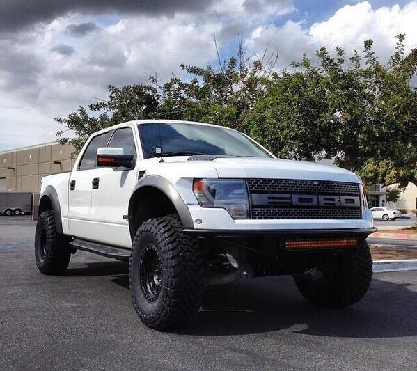 White Lifted Ford Raptor F 150 SVT Truck