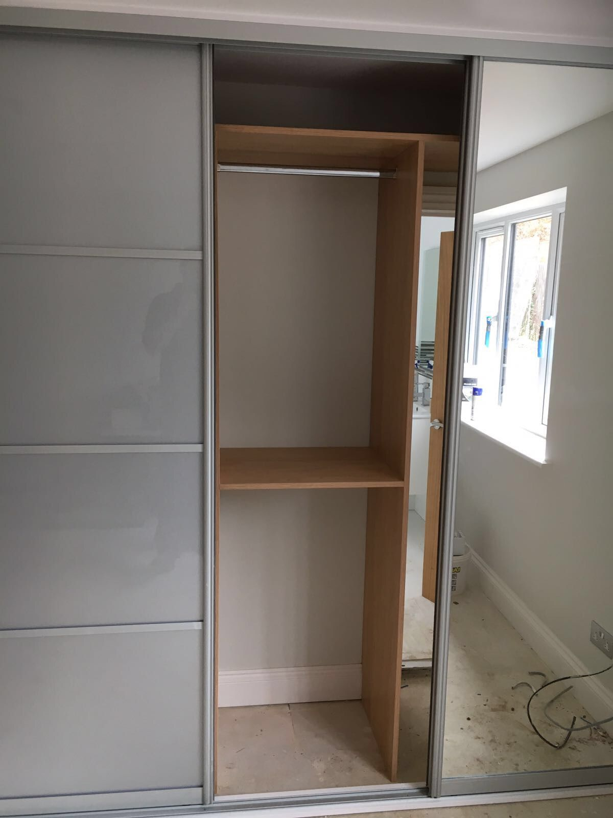 3 door sliding wardrobe silver glass and mirror doors Hidden door to bathroom