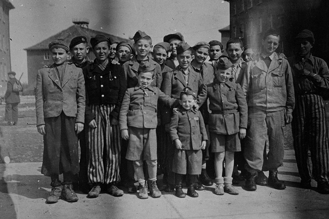 Group portrait of child survivors of Buchenwald. The young boy in the middle is Joseph Schleifstein. Behind him is Abram Wroclawski, originally from Lodz who was sent to Auschwitz before coming to Buchenwald.