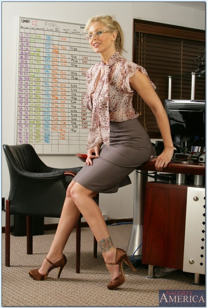Portrait Of Happy Mature Woman In Her Office Looking Out Of Window High