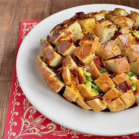One of the most popular flavor combinations on earth, in a perfectly pullable package! Bacon-Cheddar Pull Bread combines sizzling bacon, melted cheese, zingy green onion, and savory butter with chewy bread in an appetizer that will knock the socks off your friends and family. Quick and easy to toss together,Get the Recipe