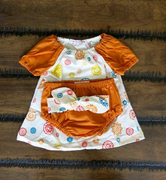 New vintage baby clothes is part of Hipster Clothes Boho - 100% Organic Cotton Retro Flower baby dress with matching Bloomers and Knotted Headband Light weight soft organic cotton, cream  with bright retro flowers in yellow, teal, coral and burnt orange  I have made the sleeves and bloomers in corresponding burnt orange  To make this the perfect outfit I have added a Knotted Headband using same cotton  The headband has some elastic in the back for added stretch and comfort, the knot can be adjusted as your little one grows  This is a very cute outfit that will standout at any special occasion Photo shoot, Baptism, Party  I would recommend machine wash in cool water and hang to dry  This will help preserve the beautiful colours   All fabric is washed using Earth Choice laundry liquid and kept in a pet and smoke free environment  Your purchase will be posted once payment has been cleared  If you are not 100% happy with your purchase and they have not been damaged in any way please send them back within 14 days for full refund  Your purchase will be sent via airmail  If you would like express or registered post at an extra cost please contact me  Thank you for taking the time to have a look around