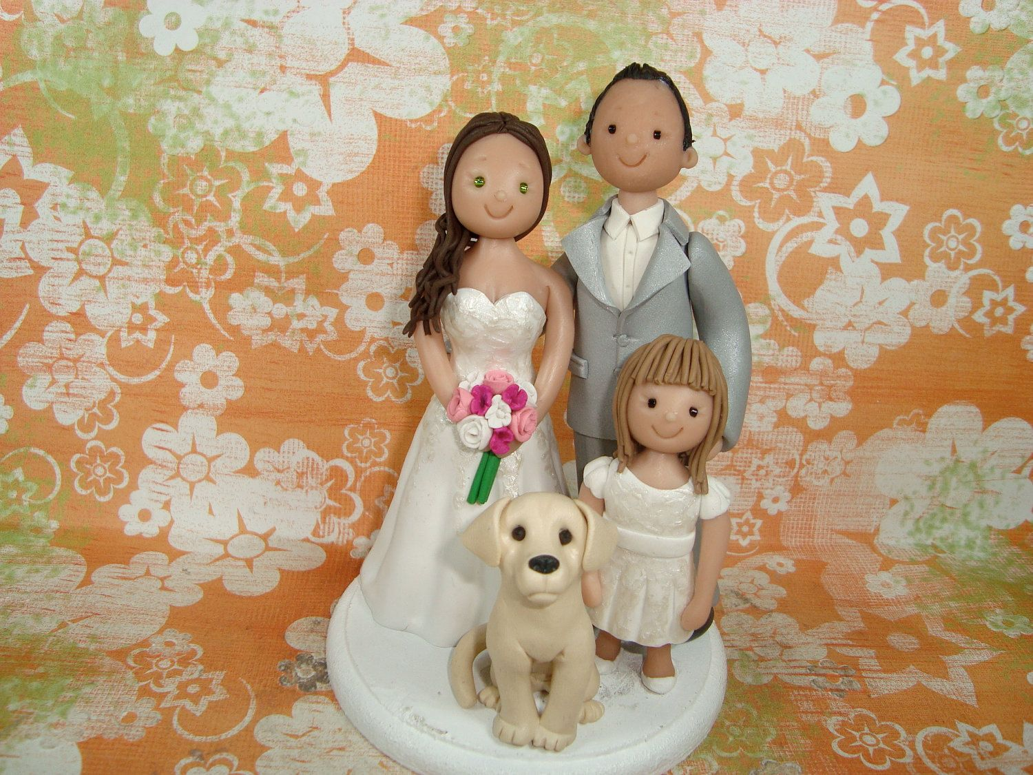 Customized bride and groom with daughter and dog wedding cake topper