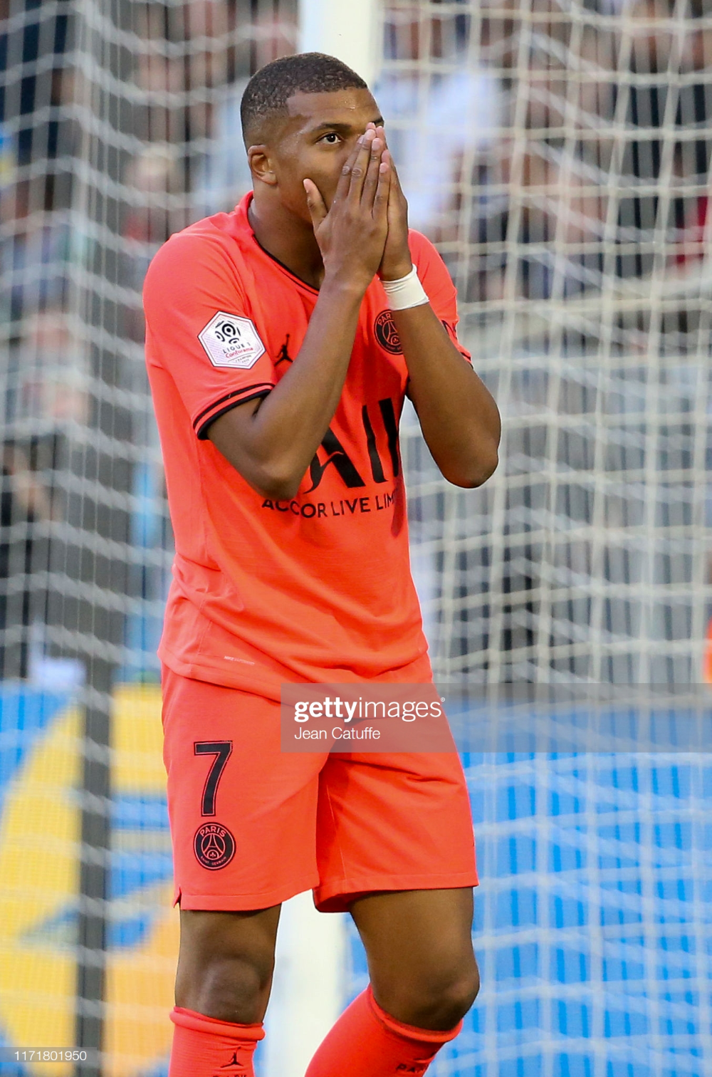 Kylian Mbappe of PSG reacts after missing a goal during