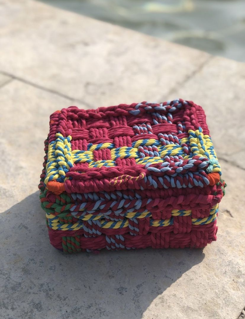 This dainty little storage box was made from the upcycled cloth rags of North Indian lehenga-cholis. The perfect companion to hide your precious notes, jewellery or anything else close to the heart. #wastetowow #wovenfurniture #vintagefurniture #charpoy #charpai #weaversofinstagram #sustainableliving #sustainabledesign #circulareconomy #circularfurniture #supportyourladies #surviveandthrive #sustainableliving #sustainablefurniture #circularfurniture #skilledsamaritan #vocalforlocal #womenentrepr