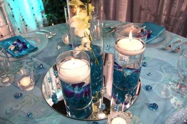 Turquoise And Silver Wedding Table Decorations Google Search Blue Wedding Centerpieces Wedding Themes Summer Summer Wedding Centerpieces