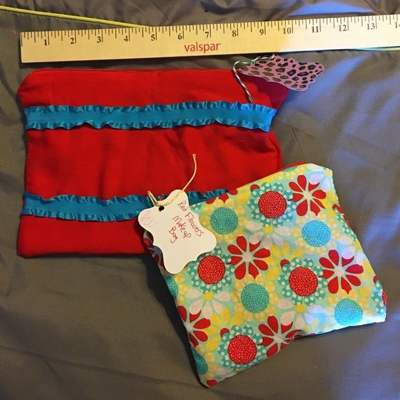 NWT. Set of 2 coordinating makeup bags. Brand new lined fabric makeup bags. Set of 2. Zipper top. One-of-a-Kind. Cute and colorful, this bag keeps your stuff organized with style! Bags Cosmetic Bags & Cases #zippertop