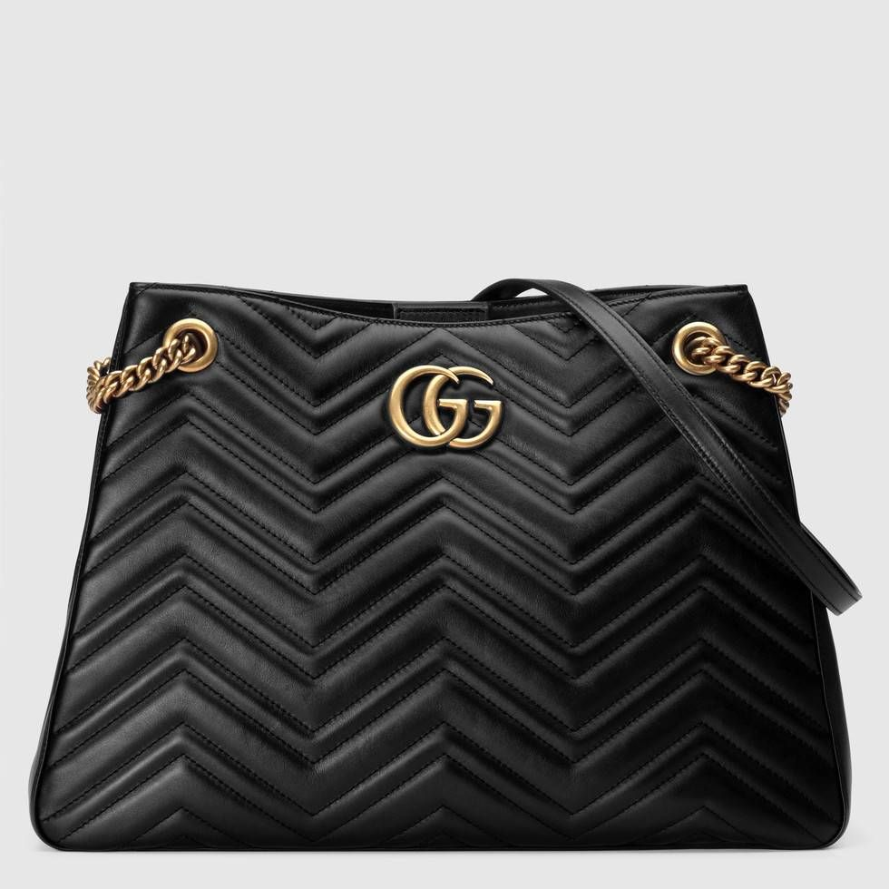 dfc7866b69e Shop the GG Marmont medium matelassé shoulder bag by Gucci. The medium GG  Marmont chain shoulder bag has a softly structured shape with Double G  hardware.
