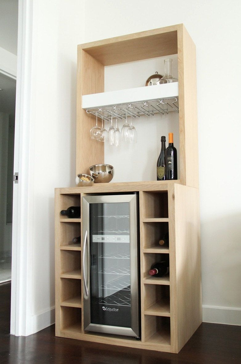 White oak bar with built in wine cooler and glass rack by for Wine rack built in