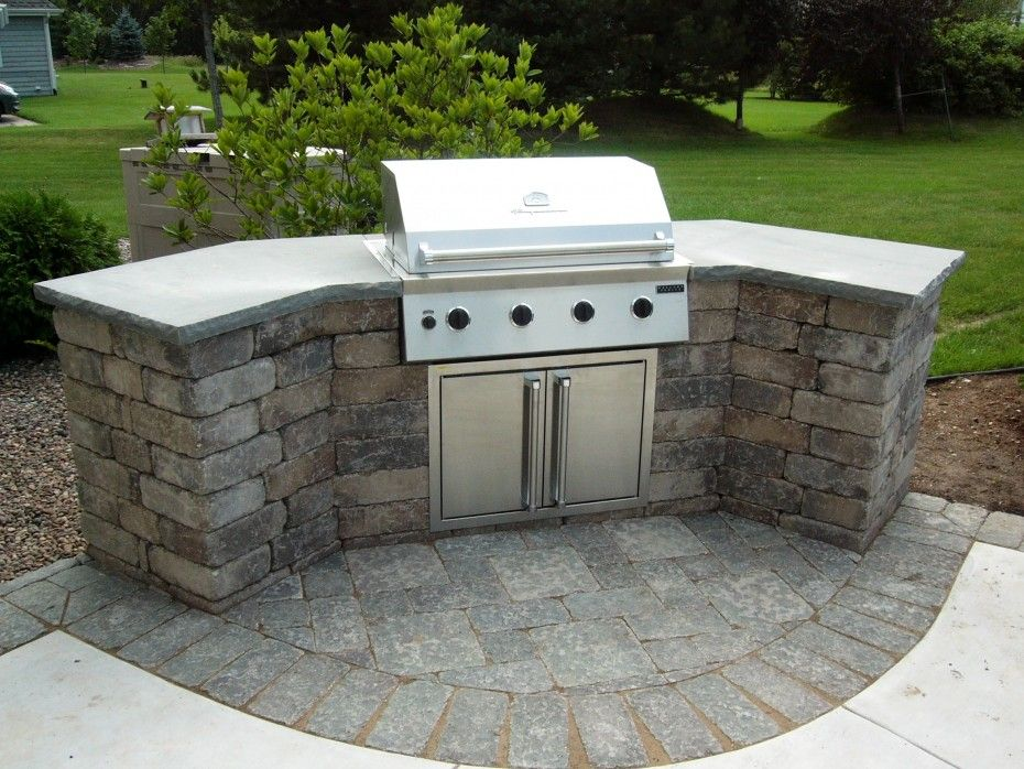 Curved Stone Prefab Kitchen Island With Gray Concrete Countertop And  Barbeque Grill On Backyard Garden Of