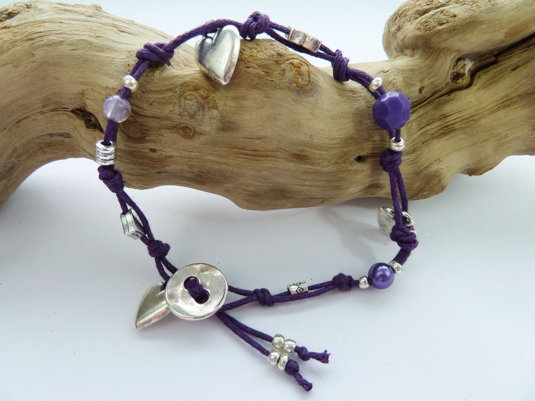 Silver and Purple Coloured Bracelet...