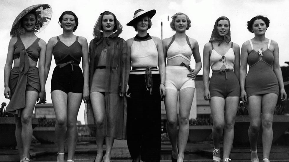May 1936: A line-up of beach fashions at a London display