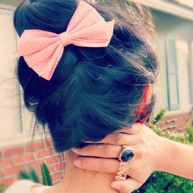 back braid up bun with a pink bow