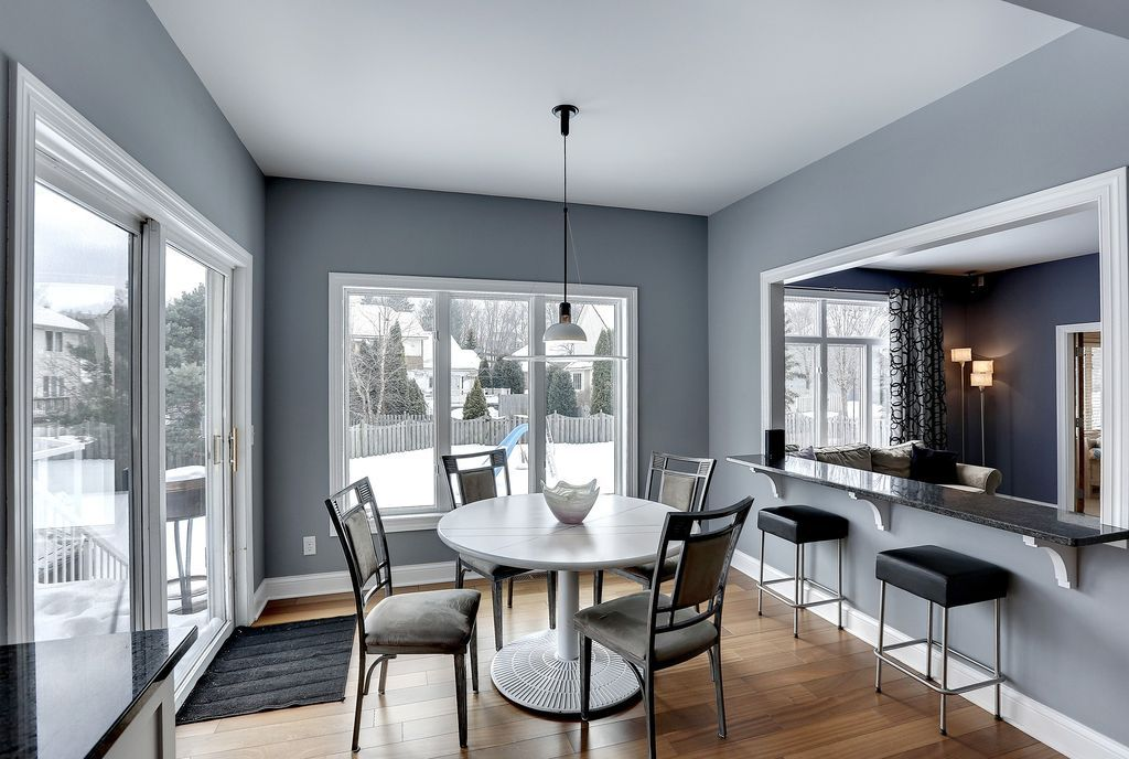 Transitional Dining Room With High Ceiling Carpet Pendant Light Hardwood Floors