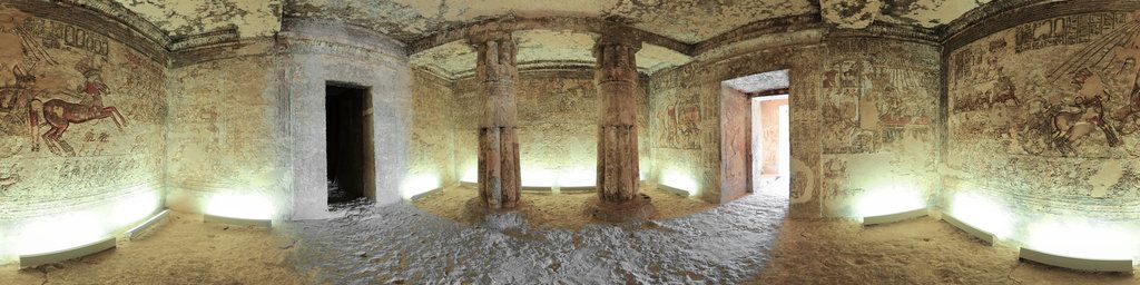 This is the view of the first hypostyle hall of the tomb of Meryra, a High Priest of Aten during the revolutionary but short reign of Akhenaten. The tomb is found in the cliffs on the northern edge of the ancient city of Akhetaten, which was abandoned soon after Akhenaten's death. Meryra's tomb was never completed, though the murals in the first hypostyle hall are considered to be some of the most beautiful around. The depiction of the sun and...