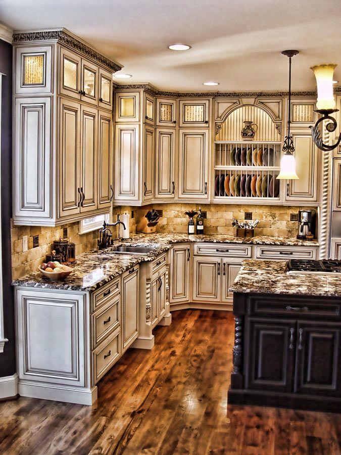 Weathered White Kitchen Cabinets Gorgeous kitchen with antiqued cabinets, gorgeous counter tops and
