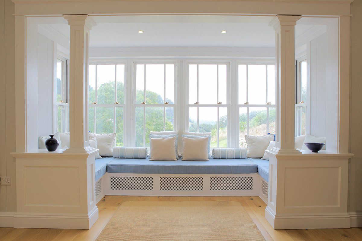 stylish and futuristic bay window with window seat design