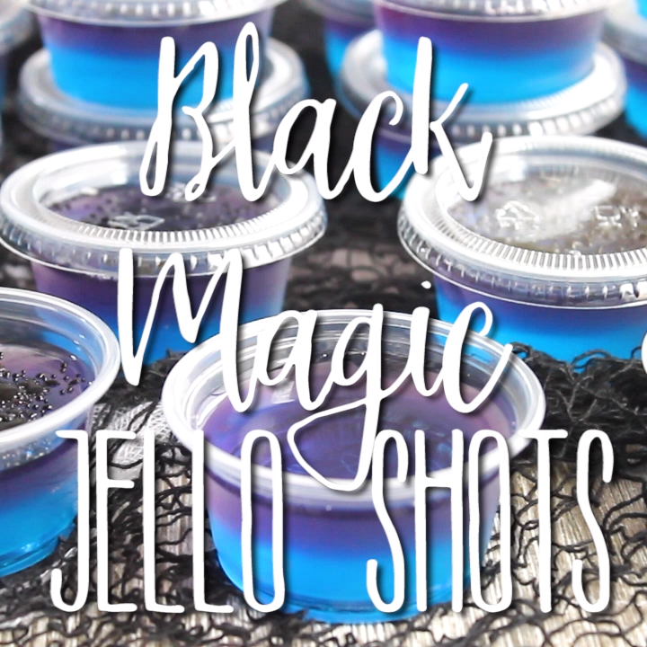 Black Magic Jello Shots are fun party shot that's perfect for Halloween! Everyone will think they're bewitching with blue and purple layers and black magic dust on top! #halloween #jelloshots #vodka #jello #party #halloweenparty