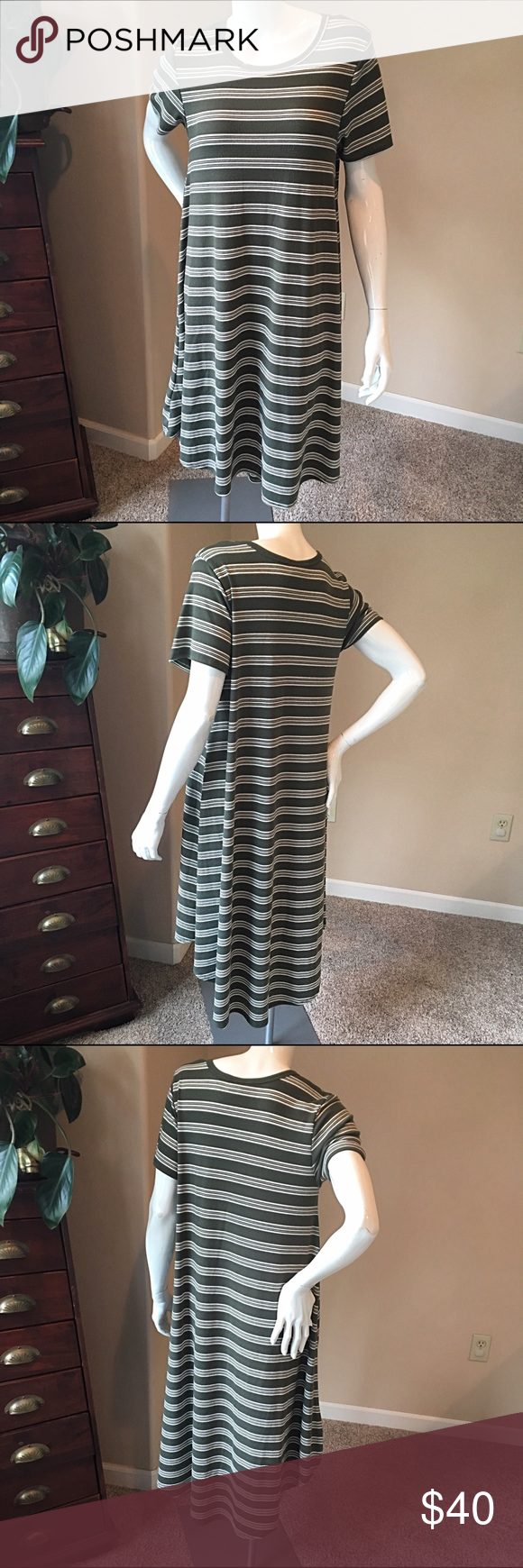 """LuLaroe S Carly green striped dress LuLaroe S Carly green striped dress. Dress is in good condition slight piling near underarm see pic. We all want a cute dress that lets us breathe and move easier, so we are excited about the Carly - a swing dress that flatters the best parts of a feminine physique while being flowy and breezy everywhere else. The Carly has a flattering high-low hemline, and cool open sleeves. Measurements bust 18"""", length 40"""". LuLaRoe Dresses Midi"""